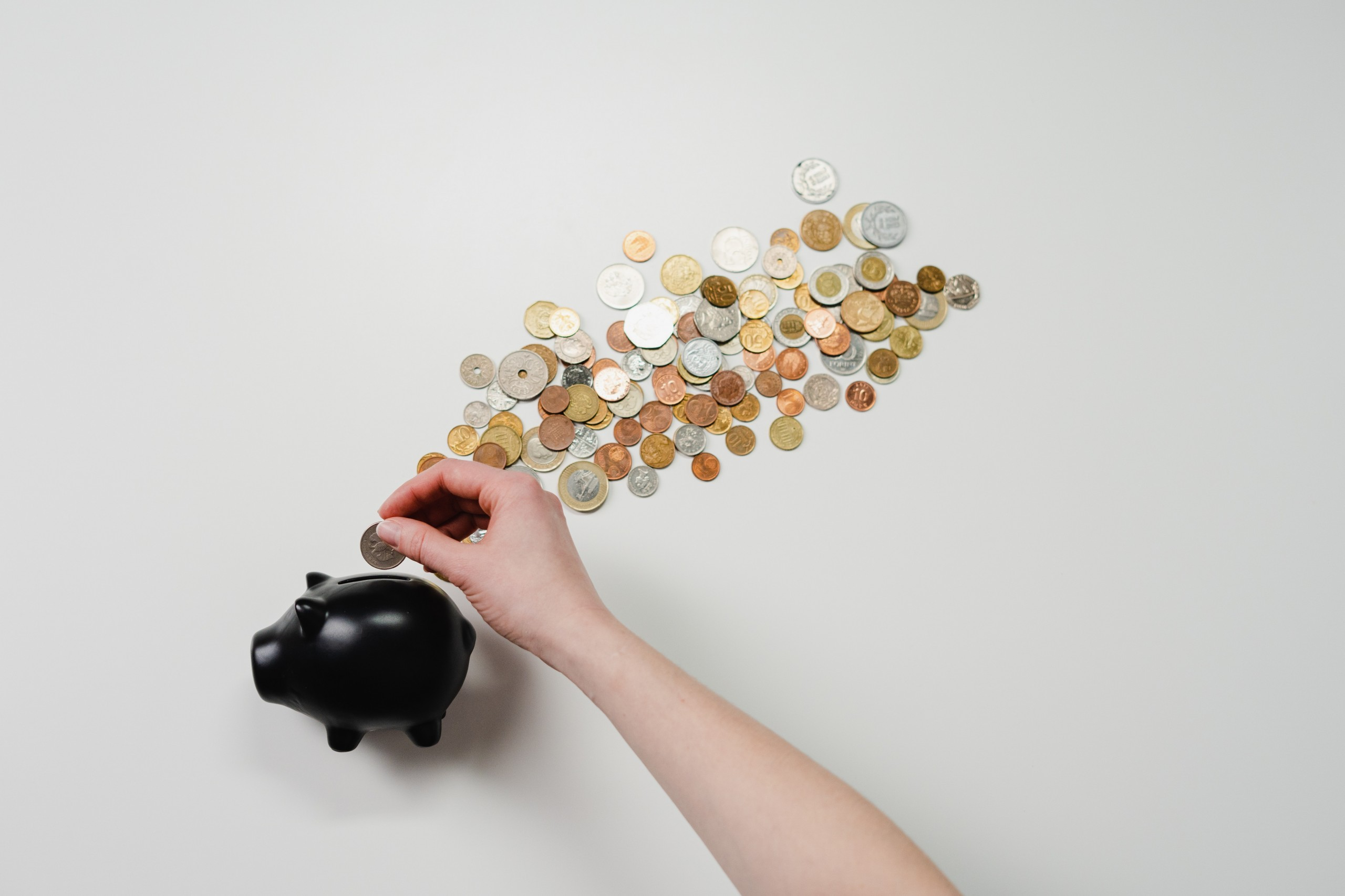Picture which represents putting money into a piggy bank